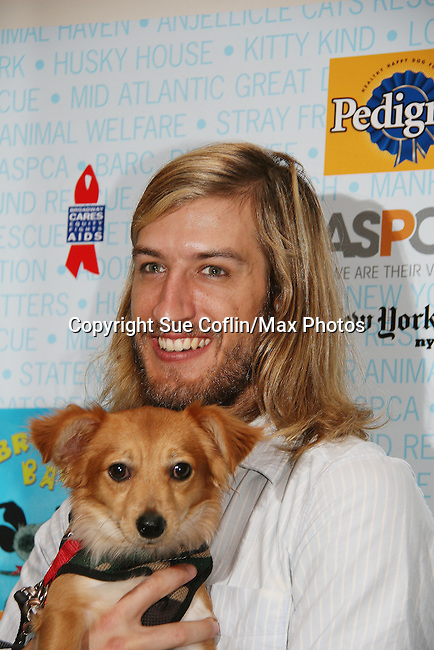 """HAIR cast - Bryce Ryness at Broadway Barks 11 - a """"Pawpular"""" star-studded dog and cat adopt-a-thon on July 11, 2009 in Shubert Alley, New York City, NY. (Photo by Sue Coflin/Max Photos)"""