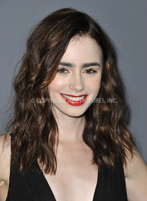 WWW.ACEPIXS.COM....February 19 2013, LA....Lilly Collins arriving at the 15th Annual Costume Designers Guild Awards at The Beverly Hilton Hotel on February 19, 2013 in Beverly Hills, California. ......By Line: Peter West/ACE Pictures......ACE Pictures, Inc...tel: 646 769 0430..Email: info@acepixs.com..www.acepixs.com