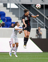 Abby Wambach (20) of the USWNT heads the ball away from Lupita Worbis (8)  of Mexico during the game at Red Bull Arena in Harrison, NJ.  The USWNT defeated Mexico, 1-0.