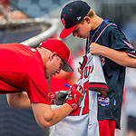 15 August 2017: Los Angeles Angels outfielder Mike Trout autographs a jersey for a young fan prior to facing the Washington Nationals at Nationals Park in Washington, DC. The Nationals defeated the Angels 3-1 in the first game of their 2-game series. Mandatory Credit: Ed Wolfstein Photo *** RAW (NEF) Image File Available ***