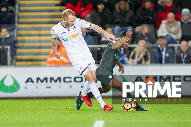 Mike van der Hoorn of Swansea City and Raheem Sterling of Manchester City during the EPL - Premier League match between Swansea City and Manchester City at the Liberty Stadium, Swansea, Wales on 13 December 2017. Photo by Mark  Hawkins / PRiME Media Images.