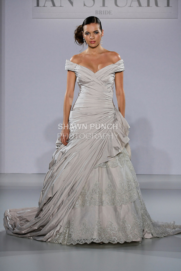 Model walks runway in a Frederique wedding dress from the Ian Stuart - Supernova Bridal Collection 2013 fashion show, at the Couture Show during New York Bridal Fashion Week, October 14, 2012.