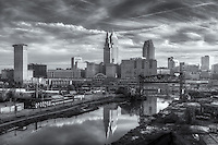 The Terminal Tower and Key Tower, lit by early morning light and reflected in the Cuyahoga River, dominate the skyline of Cleveland, Ohio.  The Terminal Tower was the 4th tallest building in the world when built in 1930 and remained the tallest in Cleveland until the completion of the Key Tower (then Society Tower) in 1991.  This view includes the abandoned Eagle Avenue Bridge, a vertical-lift bridge spanning the Cuyahoga River.