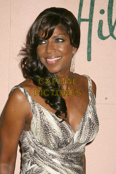 NATALIE COLE<br /> Sony BMG 2008 Grammy Awards After-Party held at the Beverly Hills Hotel Photo, Beverly Hills, California, USA.<br /> February 10th, 2008<br /> half length white brown beige pattern print dress <br /> CAP/ADM/RE<br /> &copy;Russ Elliot/AdMedia/Capital Pictures