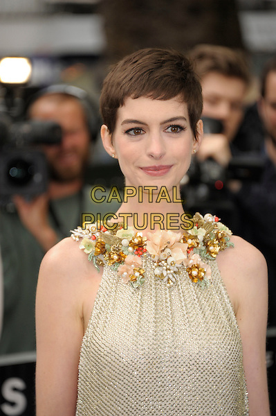 Anne Hathaway (wearing Gucci).'The Dark Knight Rises' European premiere at Odeon Leicester Square cinema, London, England..18th July 2012.headshot portrait embellished jewel encrusted flowers floral pearls collar short cropped hair sleeveless silver gold cream beige .CAP/PL.©Phil Loftus/Capital Pictures.