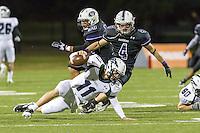 Cedar Ridge's Josh Arzola pressures McNeil quarterback Hayden Cooper in the fourth quarter at Kelly Reeves Athletic Complex.  (LOURDES M SHOAF for Round Rock Leader)