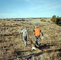 Hunting white tail deer with Jake Jacobs (cq), Richard Watkins (cq), a guide with Trophies Plus Outfitters and John Taranto (cq), a writer with Outdoor Life Magazine at Trope Ranch near Hullett, Wyoming, Wednesday, November 7, 2012.<br /> <br /> <br /> Photo by Matt Nager