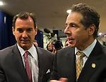 Albertson, New York, U.S. 26th October 2013. R-L, New York Governor ANDREW CUOMO endorses TOM SUOZZI for Nassau County Executive, at the Albertson Veterans of Foreign Wars VFW Post. Democrat Suozzi, the former Nassau County Executive, and Republican incumbent Mangano face each other in a rematch in the upcoming November 5th election.