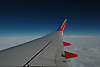 Southwest Airlines Wing above the clouds.