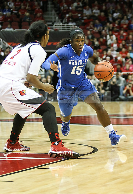 Kentucky guard Linnae Harper drives the ball during the first half of the Kentucky vs. Louisville women's basketball game at the KFC Yum! Center on Sunday, December 7, 2014 in Lexington, Ky. Louisville leads Kentucky 42-29 at halftime. Photo by Adam Pennavaria | Staff