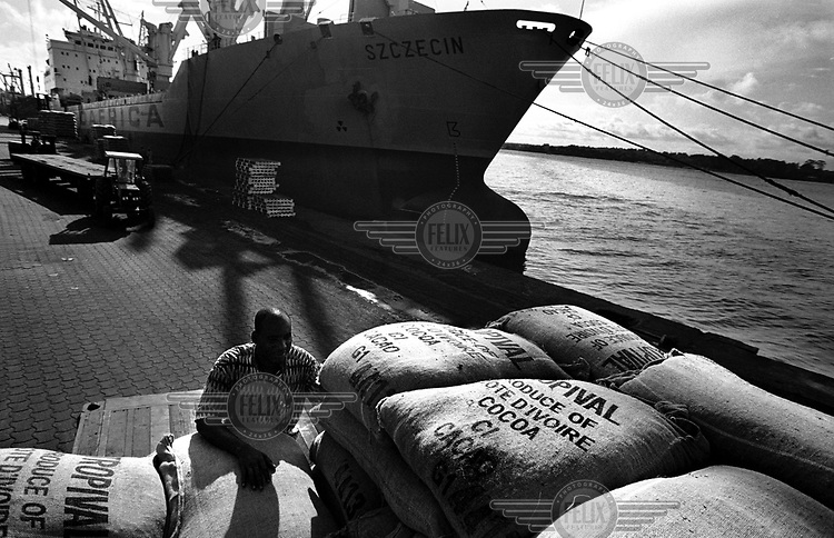 Cocoa beans being loaded onto a cargo ship at the port. The country is among the worldÕs largest producers of cocoa.