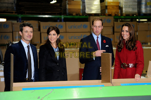 Crown Prince Frederik of Denmark,  Crown Princess Mary of Denmark, Prince William, Duke of Cambridge & Catherine, Duchess of Cambridge.The Duke and Duchess of Cambridge visit UNICEF's Emergency Supply Centre, UNICEF Supply Division, UNICEF Plads, Freeport, Copenhagen, Denmark..November 2nd, 2011.half length royal royalty kate catherine prince blue black suit red coat married husband wife factory line box boxes workers.CAP/CAS.©Bob Cass/Capital Pictures.