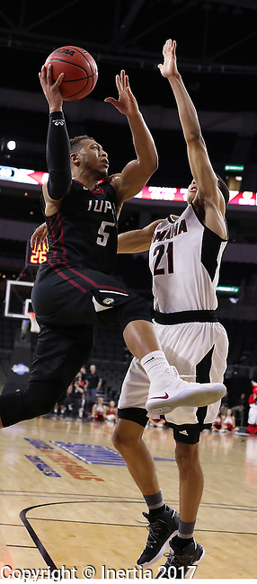 SIOUX FALLS, SD: MARCH 6: Kellon Thomas #5 of IUPUI drives on Zach Jackson #21 of Omaha during the Summit League Basketball Championship on March 6, 2017 at the Denny Sanford Premier Center in Sioux Falls, SD. (Photo by Dick Carlson/Inertia)