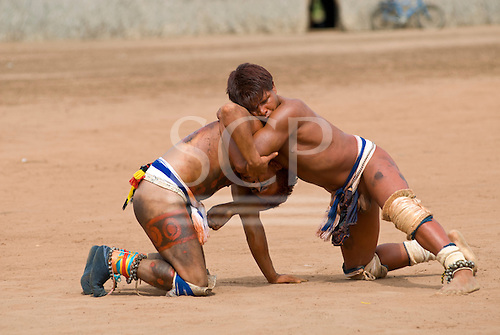 Xingu Indigenous Park, Mato Grosso State, Brazil. Aldeia Matipu (Matipu). Practicing Huka-Huka fighting. Autamaco and Maike.