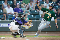 Winston-Salem Dash catcher Omar Narvaez (22) waits for the throw as Paul Hendrix (4) of the Lynchburg Hillcats starts his slide into home plate at BB&T Ballpark on May 29, 2015 in Winston-Salem, North Carolina.  The Dash defeated the Hillcats 8-1.  (Brian Westerholt/Four Seam Images)