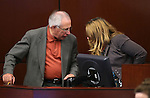 Nevada Assembly leaders Pat Hickey, R-Reno, and Marilyn Kirkpatrick, D-North Las Vegas, talk on the Assembly floor at the Legislative Building in Carson City, Nev., on Sunday, June 2, 2013. <br /> Photo by Cathleen Allison