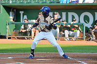 Devan Ahart (18) of the Ogden Raptors at bat against the Great Falls Voyagers in Pioneer League action at Lindquist Field on July 17, 2014 in Ogden, Utah.  (Stephen Smith/Four Seam Images)