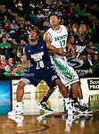 Jackson State Tigers forward Sydney Coleman (20) and North Texas Mean Green forward Tony Mitchell (13) in action during the game between the Jackson State Tigers and the University of North Texas Mean Green at the North Texas Coliseum,the Super Pit, in Denton, Texas. UNT defeated Jackson State 69 to 55.