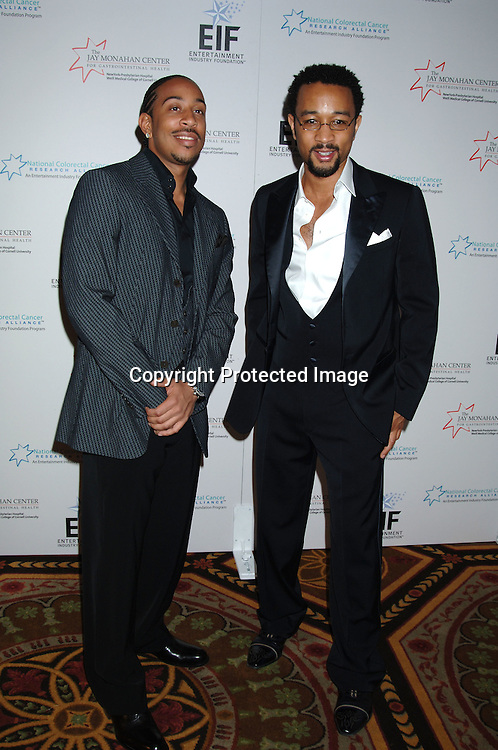 Ludacris and John Legend ..at The Entertainment Industry Foundation National Colorectal Cancer Research Alliance and The Jay Monahan Center for Gastrointestinal Health Hollywood Meets Motown Benefit on March 15, 2006 at The Waldorf Astoria Hotel. ..Robin Platzer, Twin Images