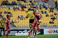 Michael Boxall and Bruce Djite during the A League - Wellington Phoenix v Adelaide United, Wellington, New Zealand on Sunday 30 March 2014. <br /> Photo by Masanori Udagawa. <br /> www.photowellington.photoshelter.com.