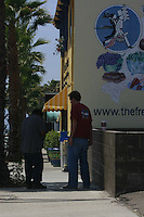May 15 2008, Pacific Beach, San Diego, CA, USA:  A plain-clothes ICE agent stops a man on Turquoise Street near the French Gourmet restaurant that was raided earlier in the day.  After speaking with the agent for a few minutes, the man was allowed to continue on his way.
