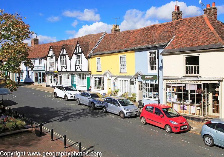 Colourful shops historic buildings, Market Hill, Woodbridge, Suffolk, England, UK