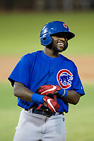 AZL Cubs third baseman Delvin Zinn (21) laughs with assistant hitting coach Leonel Perez (66) after an RBI-single in the fifth inning against the AZL Giants on September 7, 2017 at Scottsdale Stadium in Scottsdale, Arizona. AZL Cubs defeated the AZL Giants 13-3 to win the Arizona League Championship Series two games to one. (Zachary Lucy/Four Seam Images)