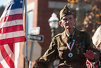 NWA Democrat-Gazette/J.T. WAMPLER  Eugene Keister of Fayetteville rides in a Veterans Day parade Sunday Nov. 8, 2015 in downtown Fayetteville. Keister served under General Patton in World War II. The parade was sponsored by the Northwest Arkansas Veterans Day Association.