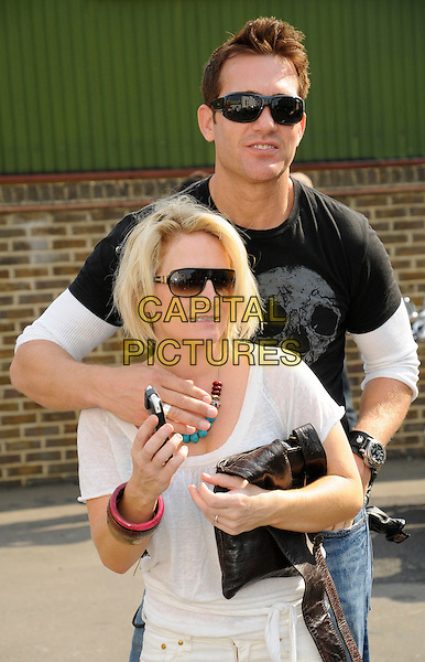 LUCY SPEED.At the Harley Davidson Celebrity bike ride, Warr's Harley Davidson, Kings Road, London, England, UK, .9th August 2009..half length white t-shirt sunglasses shades hand .CAP/CAN.©Can Nguyen/Capital Pictures