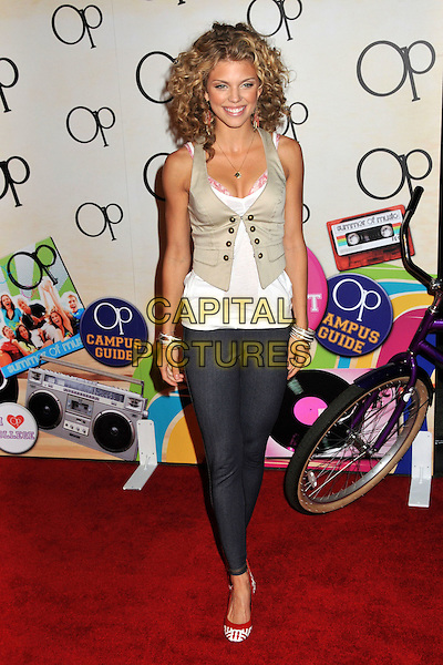 "ANNALYNNE McCORD.Op Launches ""OPen Campus"" Fall Ad Campaign held at Mel's Diner, West Hollywood, CA, USA..July 7th, 2009.full length waistcoat beige white pink bra cleavage leggings jean denim red shoes .CAP/ADM/BP.©Byron Purvis/AdMedia/Capital Pictures."