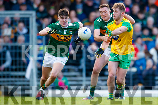 Seán Ó Sé and Brendan O'Sullivan Kerry in action against Stephen McMenamin Donegal in the Allianz Football League Division 1 Round 1 match between Kerry and Donegal at Fitzgerald Stadium in Killarney, Co. Kerry.