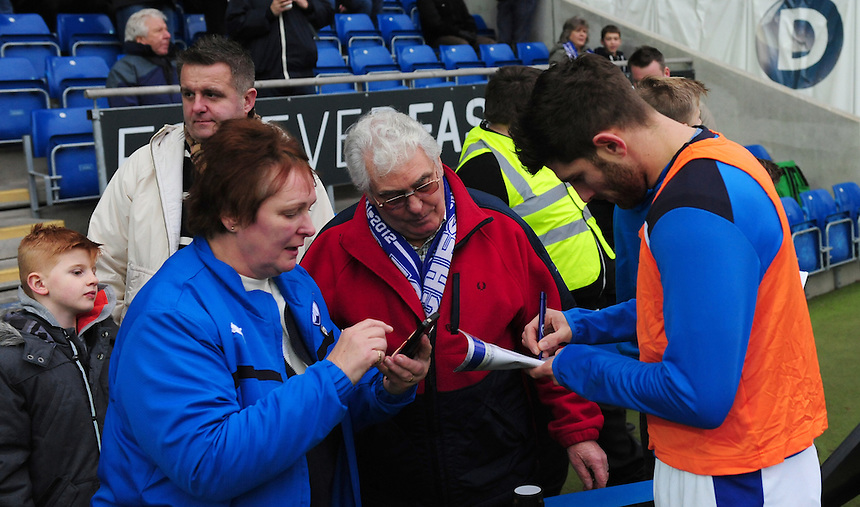 Chesterfield's Ched Evans signs an autograph for fans during the pre-match warm-up <br /> <br /> Photographer Chris Vaughan/CameraSport<br /> <br /> The Emirates FA Cup Second Round - Chesterfield v Wycombe Wanderers - Saturday 3rd December 2016 - Proact Stadium - Chesterfield<br />  <br /> World Copyright &copy; 2016 CameraSport. All rights reserved. 43 Linden Ave. Countesthorpe. Leicester. England. LE8 5PG - Tel: +44 (0) 116 277 4147 - admin@camerasport.com - www.camerasport.com