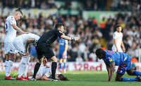 Leeds United's Luke Ayling lies prone after a collision with Bolton Wanderers' Clayton Donaldson as referee Tony Harrington calls for assistance<br /> <br /> Photographer Andrew Kearns/CameraSport<br /> <br /> The EFL Sky Bet Championship - Leeds United v Bolton Wanderers - Saturday 23rd February 2019 - Elland Road - Leeds<br /> <br /> World Copyright © 2019 CameraSport. All rights reserved. 43 Linden Ave. Countesthorpe. Leicester. England. LE8 5PG - Tel: +44 (0) 116 277 4147 - admin@camerasport.com - www.camerasport.com