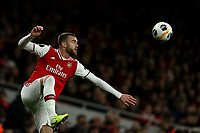 28th November 2019; Emirates Stadium, London, England; UEFA Europa League Football, Arsenal versus Frankfurt; Calum Chambers of Arsenal controls the high ball - Editorial Use