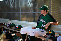 Dartmouth Big Green starting pitcher Jack Fossand (30) in the dugout during a game against the Northeastern Huskies on March 3, 2018 at North Charlotte Regional Park in Port Charlotte, Florida.  Northeastern defeated Dartmouth 10-8.  (Mike Janes/Four Seam Images)