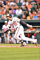 Baltimore Orioles third baseman Manny Machado #13 swings at a pitch during a game against the New York Yankees at Oriole Park at Camden Yards August 11, 2014 in Baltimore, Maryland. The Orioles defeated the Yankees 11-3. (Tony Farlow/Four Seam Images)