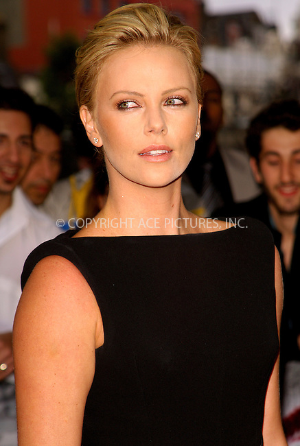 Charlize Theron at the UK premiere of 'Hancock' at Vue West End in London - 18 June 2008..FAMOUS PICTURES AND FEATURES AGENCY 13 HARWOOD ROAD LONDON SW6 4QP UNITED KINGDOM tel +44 (0) 20 7731 9333 fax +44 (0) 20 7731 9330 e-mail info@famous.uk.com www.famous.uk.com.FAM23359