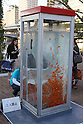 October 28, 2011, Osaka, Japan - A school of gold fish swim leisurely in the water not in a usual fish bowl or an aquarium but in a public phone booth complete with a telephone handset at Nakanoshima Park in Osaka, western Japan,  on Friday, October 28, 2011. The phone booth-turned-aquarium is a form of public art, aiming at raising awareness among people about the way the gold fish are mass-produced and consumed. (Photo by Akihiro Sugimoto/AFLO) [1080] -mis-