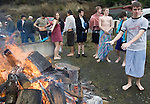 Nick Dunn warms up by the fire after participating in the 26th annual Polar Bear jump into the Burley Lagoon in Olalla, Washington on 1 January  2010. Over 300 hardy participants  braved the chilly lagoon waters to join in on the annual New Year's Day Tradition.  Jim Bryant Photo. ©2010. ALL RIGHTS RESERVED.