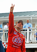 Aug. 8, 2009; Watkins Glen, NY, USA; NASCAR Nationwide Series driver Marcos Ambrose celebrates after winning the Zippo 200 at Watkins Glen International. Mandatory Credit: Mark J. Rebilas-