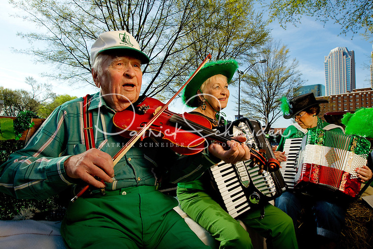 Photography of the Charlotte NC St. Patrick's Day Parade in March 2012. Image shows members of the Carolina Accordion - Banjo Association performing in the parade. Photography is part of a series of St. Patrick's Day Parade photos in Charlotte, NC.