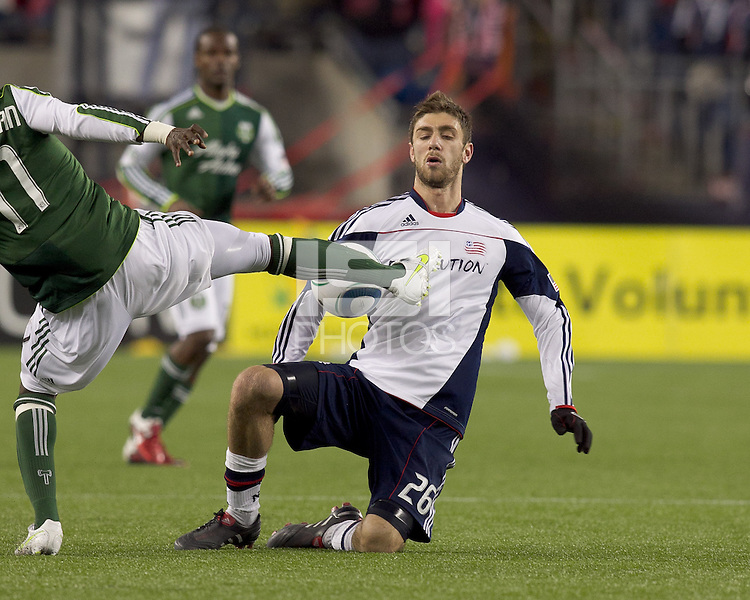 New England Revolution midfielder Stephen McCarthy (26) goes low on defense. In a Major League Soccer (MLS) match, the New England Revolution tied the Portland Timbers, 1-1, at Gillette Stadium on April 2, 2011.