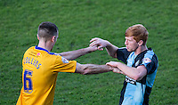 Lee Collins of Mansfield Town becomes frustrated with Ryan Sellers of Wycombe Wanderers during the Sky Bet League 2 match between Wycombe Wanderers and Mansfield Town at Adams Park, High Wycombe, England on 25 March 2016. Photo by Andy Rowland.