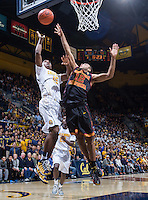 California's Jordan Matthews shoots for the basket during a game against USC at Haas Pavilion in Berkeley, California on February 23th, 2014. California defeated USC 77 - 64