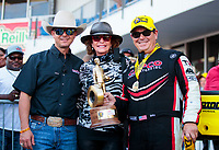 Oct 20, 2019; Ennis, TX, USA; NHRA top fuel driver Steve Torrence (left) and mother Kay Torrence (center) celebrate with father Billy Torrence after winning the Fall Nationals at the Texas Motorplex. Mandatory Credit: Mark J. Rebilas-USA TODAY Sports