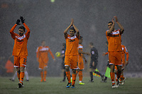 Pictured L-R: Team mates Angel Rangel, Neil Taylor and Steven Caulker of Swansea greeting supporters after the final whistle. Saturday, 04 February 2012<br />