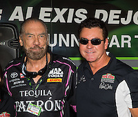 Oct 15, 2016; Ennis, TX, USA; NHRA funny car sponsor John Paul DeJoria (left) and Papa Johns Pizza owner John Schnatter during qualifying for the Fall Nationals at Texas Motorplex. Mandatory Credit: Mark J. Rebilas-USA TODAY Sports