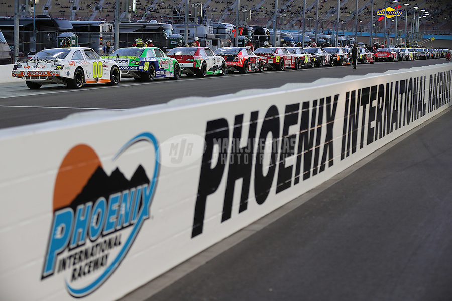 Mar. 1, 2013; Avondale, AZ, USA; Overall view of NASCAR Mexico Series cars on pit road prior to the Toyota 120 at Phoenix International Raceway. Mandatory Credit: Mark J. Rebilas-