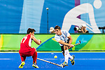 Gonzalo Peillat #2 of Argentina passes the ball while Thomas Briels #17 of Belgium tries to prevent during Argentina vs Belgium  in the men's gold medal game at the Rio 2016 Olympics at the Olympic Hockey Centre in Rio de Janeiro, Brazil.
