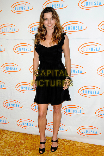 LINDA CARDELLINI .Lupus LA's 7th Annual Bag Ladies Luncheon to raise funds for lupus research at the Beverly Wilshire Four Seasons Hotel in Beverly Hills, California, USA..November 18th, 2009.full length black dress bracelets sleeveless peep toe shoes.CAP/ROT.©Lee Roth/Capital Pictures